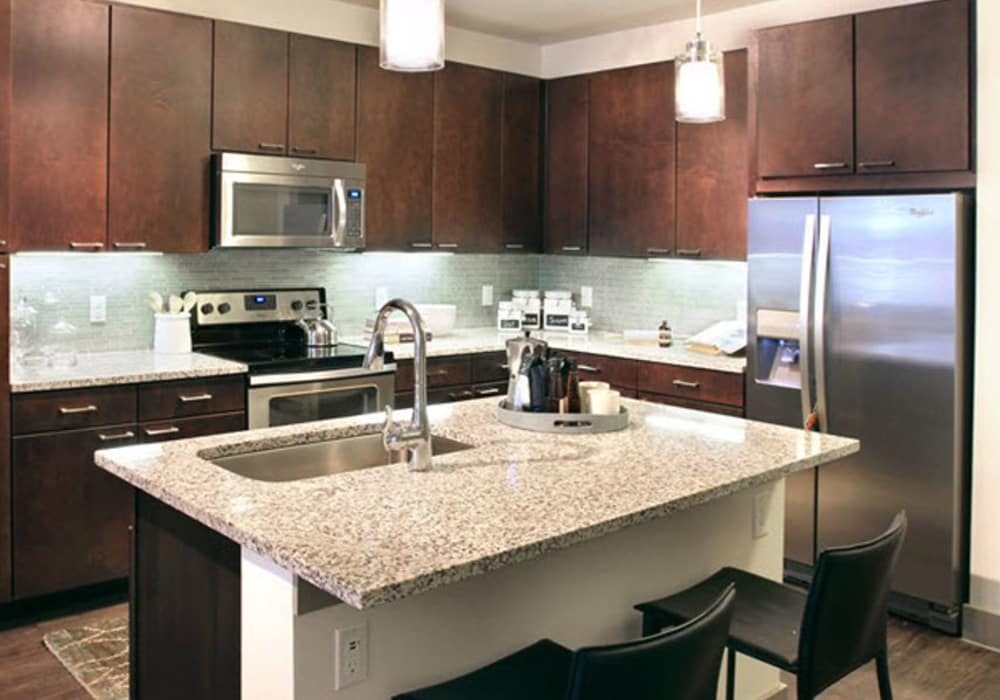 Kitchen with stainless steel appliances at Axis at The Rim in San Antonio, Texas