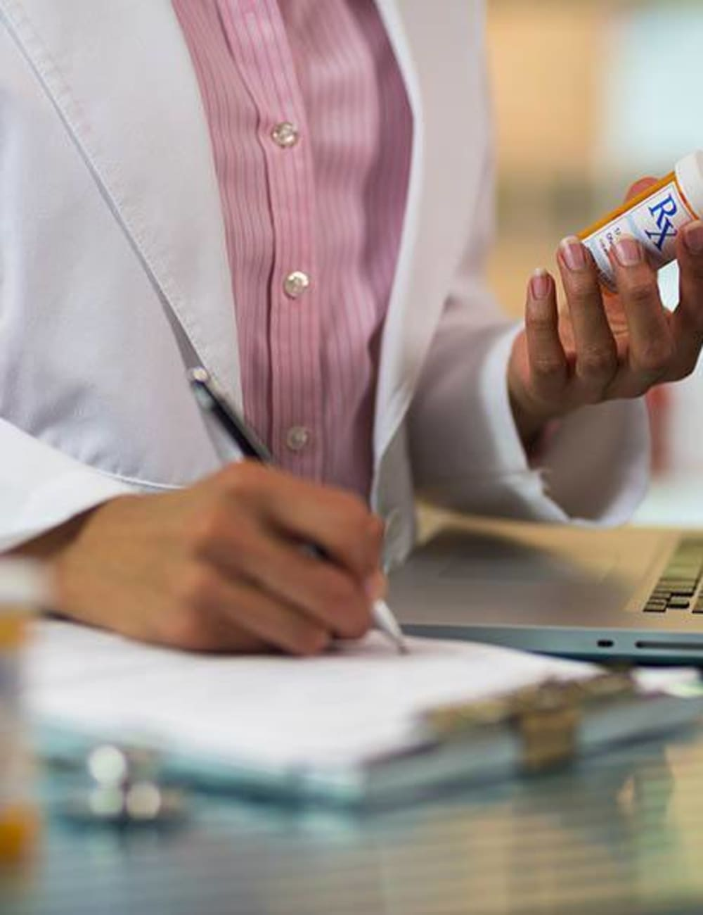 Healthcare worker checking prescriptions