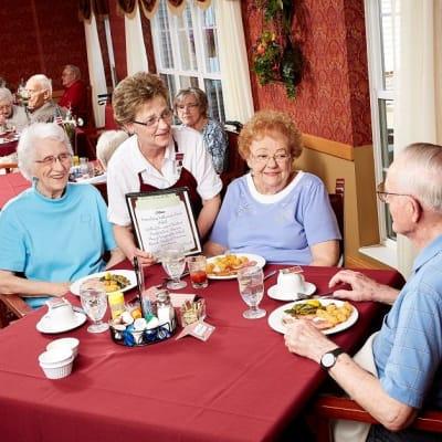 Wait-staff member taking a residents order at Deer Crest Senior Living in Red Wing, Minnesota