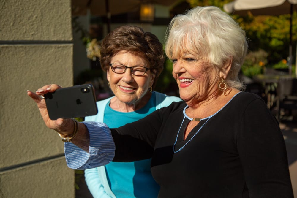 Ladies taking at selfie at our senior living community in Willow Glen