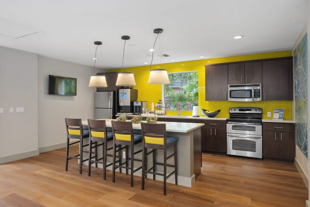 Community kitchen with bar seating at Waterhouse Place in Beaverton, Oregon