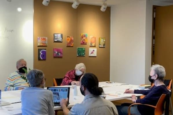 Residents Attending a Drawing Series in the Art and Crafts Room