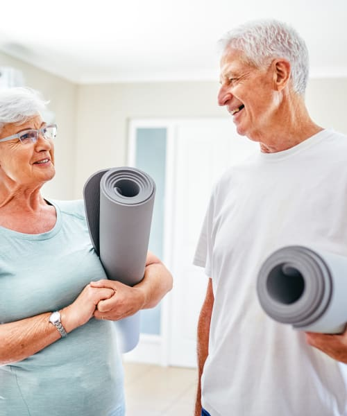 Residents with matts in the fitness center at The Springs at Lake Oswego in Lake Oswego, Oregon