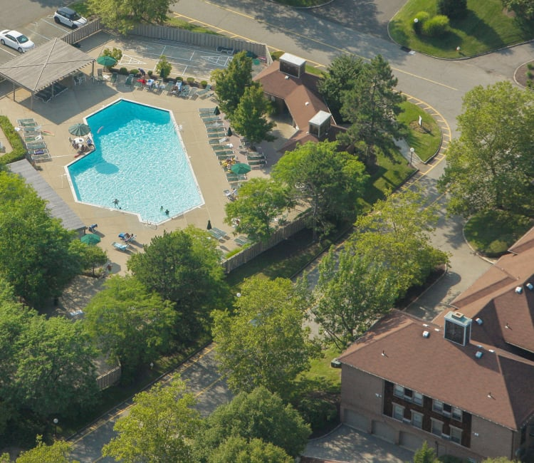 Aerial view of gorgeous swimming pool and units at Everly Roseland in Roseland, New Jersey