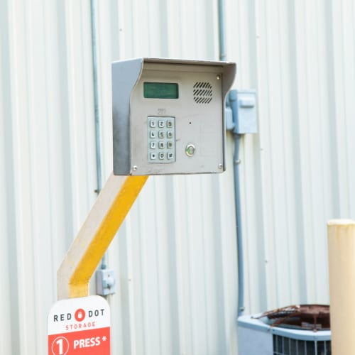 Secure entry keypad outside storage units at Red Dot Storage in Cedar Falls, Iowa