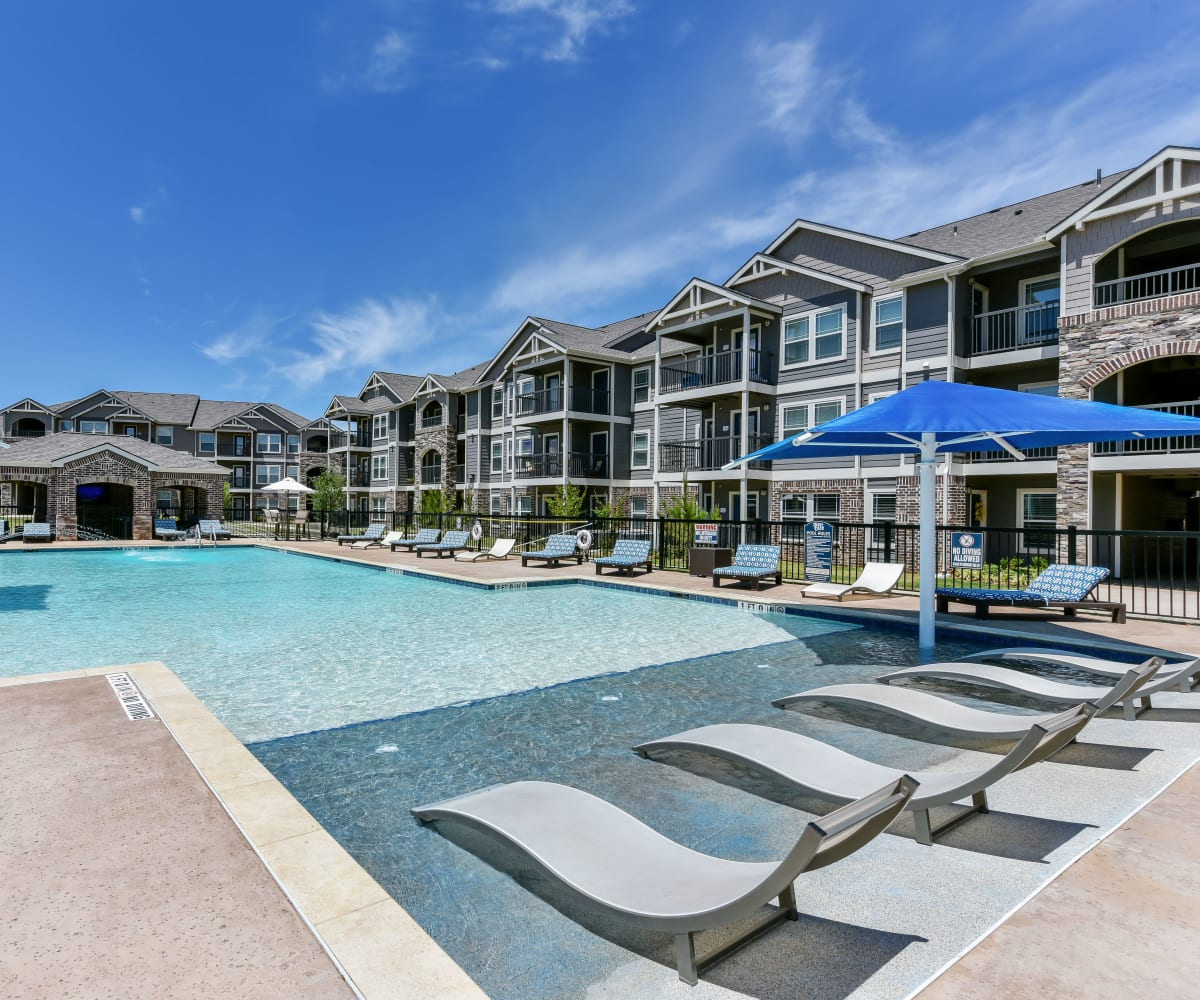 Resort-style swimming pool at Cottages at Abbey Glen Apartments in Lubbock, Texas