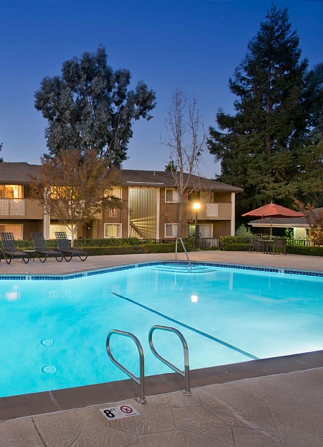 Beautiful swimming pool at dusk at Shadow Oaks Apartment Homes in Cupertino, California