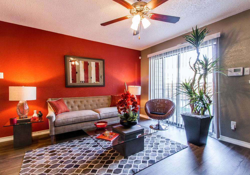 Colorful modern living room at Sausalito Apartments in College Station, Texas