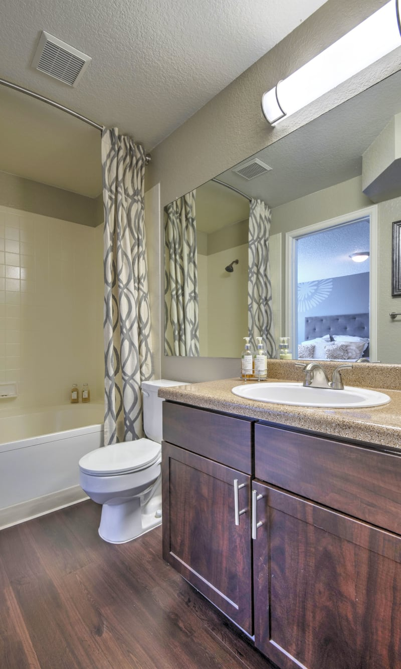 Bathroom, brown renovation at Arapahoe Club Apartments