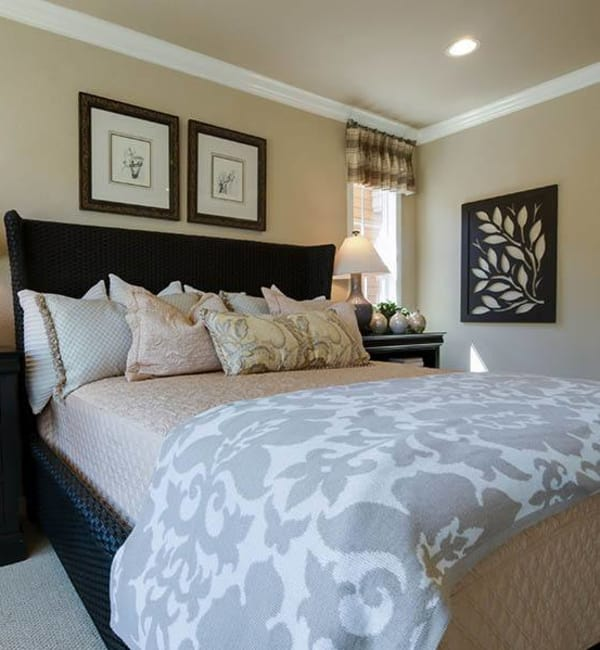 Bed with night stand at Brightwater Senior Living of Highland in Highland