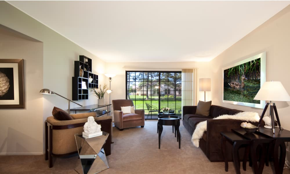 Enjoy a naturally well-lit living room at Muirwood in Farmington Hills, Michigan