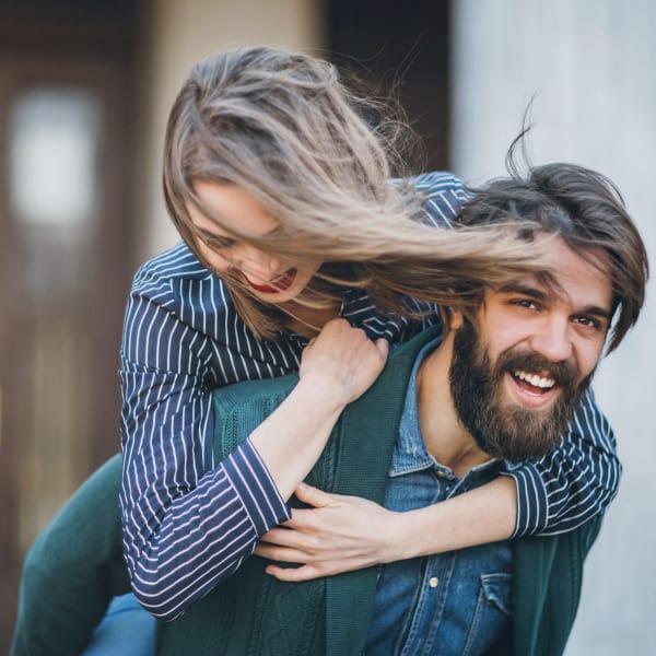Happy couple playing outside The Barrett in Marietta, Georgia