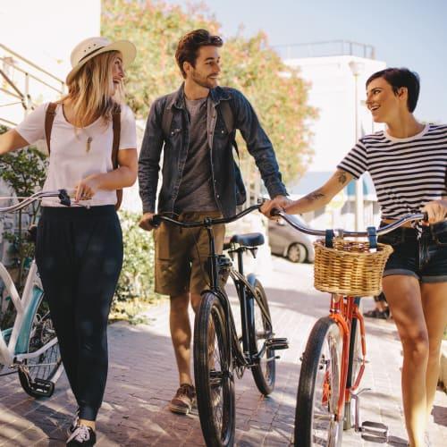 Residents walking their bikes near Social 28 in Gainesville, Florida
