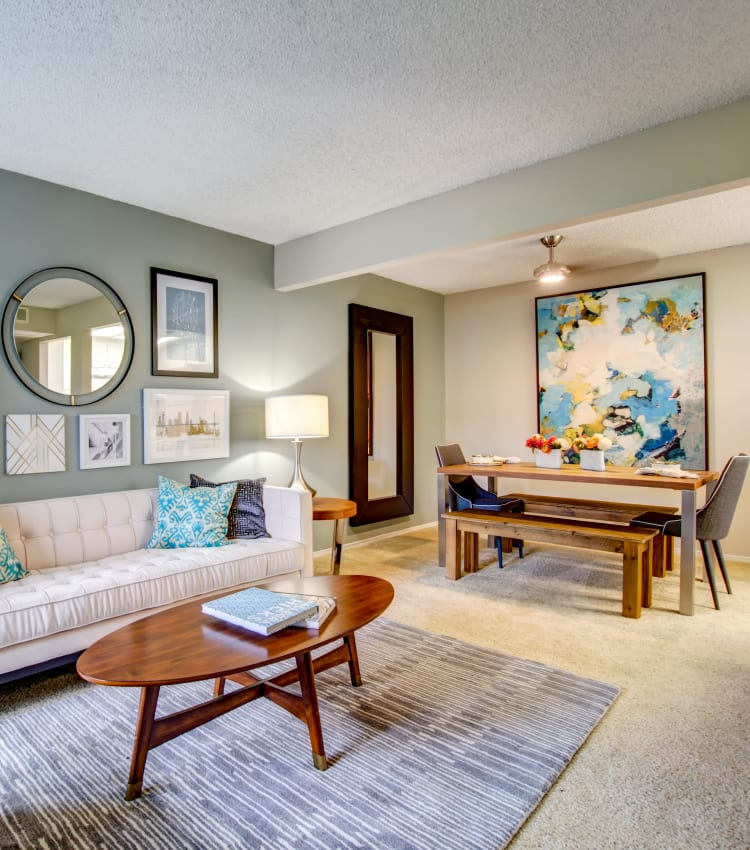 Dining area with a ceiling fan next to the living area in the open-concept floor plan of a model home at Vue Fremont in Fremont, California