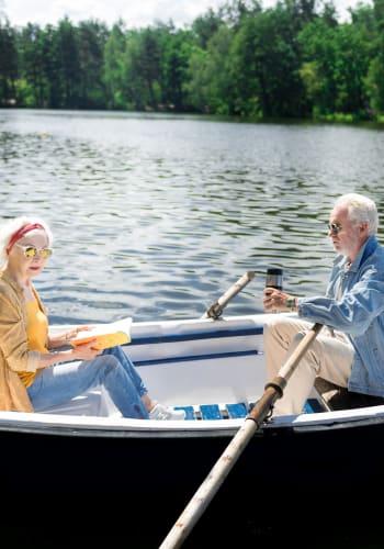 Seniors enjoying time in a canoe near The Iris Senior Living in Great Falls, Montana
