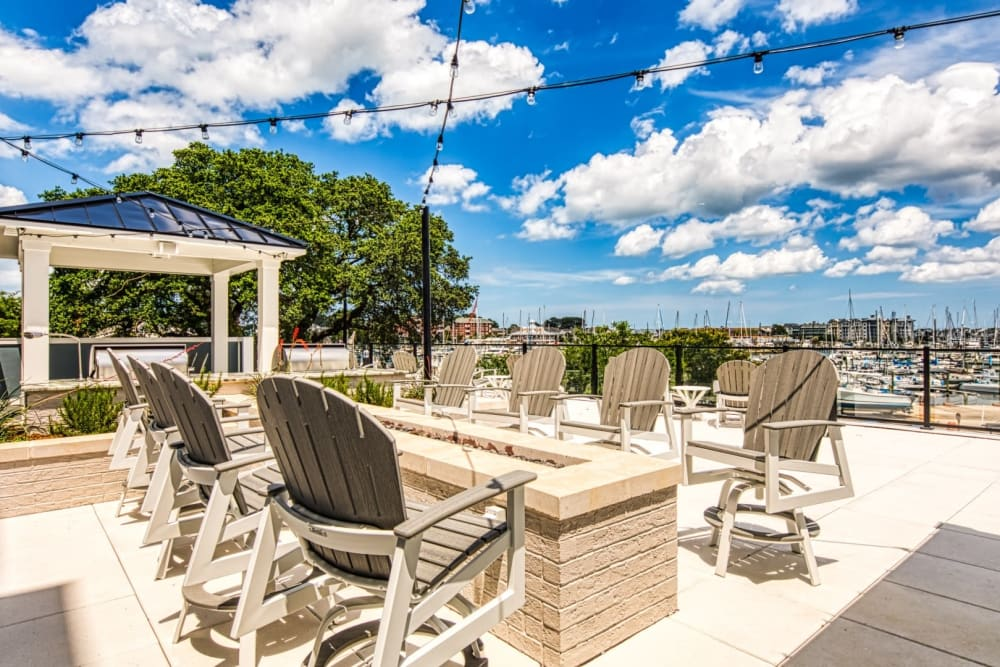 Clubhouse patio with an outdoor fireplace at Marina Villa in Norfolk, Virginia