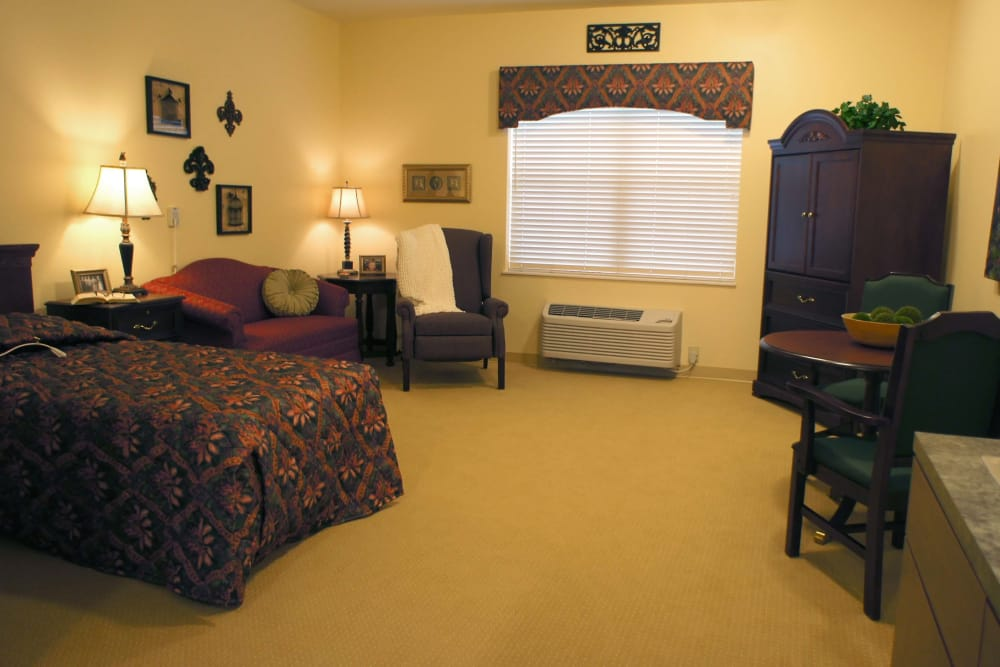 Spacious assisted living bedroom at The Lakes of Monclova in Maumee, Ohio