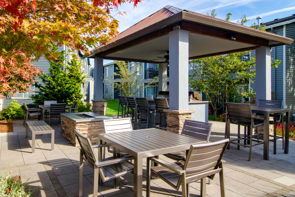 Picnic area on a sunny day at The Addison Apartments in Vancouver, Washington