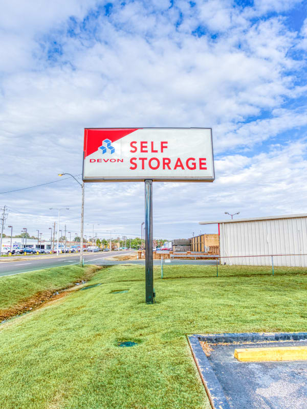 Sign in front of entry into Devon Self Storage in Memphis, Tennessee
