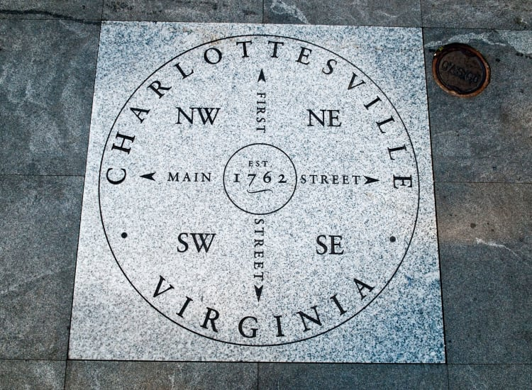 Directional stone on the pedestrian mall downtown near North Woods in Charlottesville, Virginia
