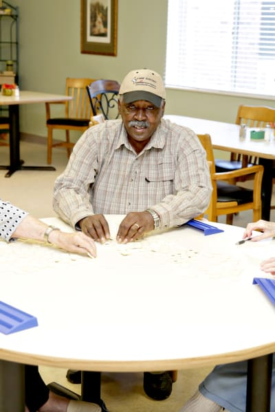 A resident playing a card game at Providence Assisted Living in Cleveland, Mississippi.