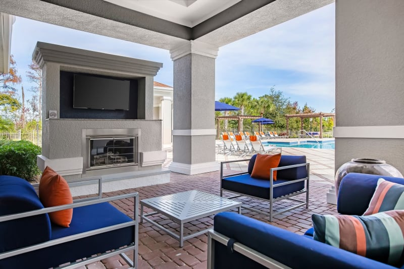 Clubhouse interior with lounge seating at The Aspect in Kissimmee, Florida