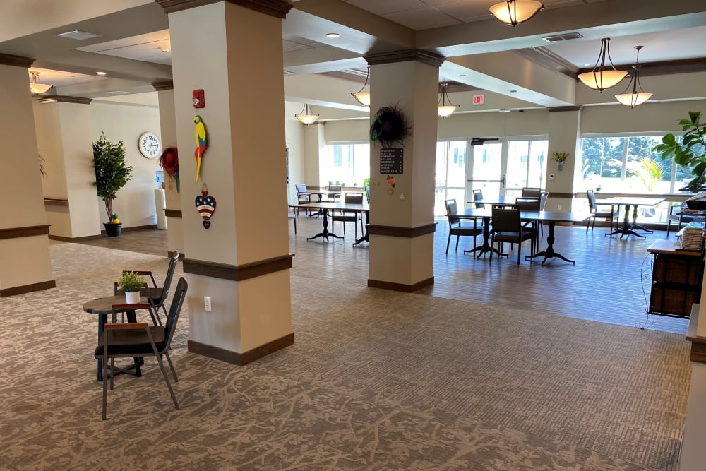 Common space with bright windows and tables at Country Meadow Place in Mason City, Iowa