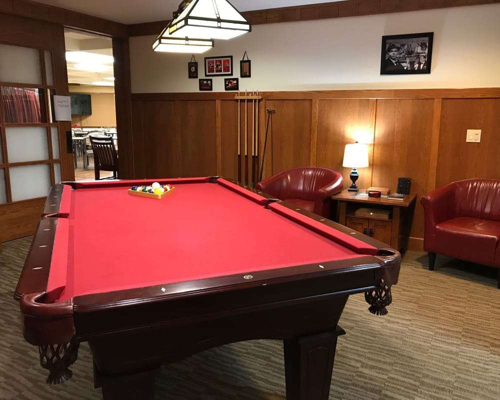 Game room with full-size pool table at Prairie Hills Senior Living in Cedar Rapids, Iowa.