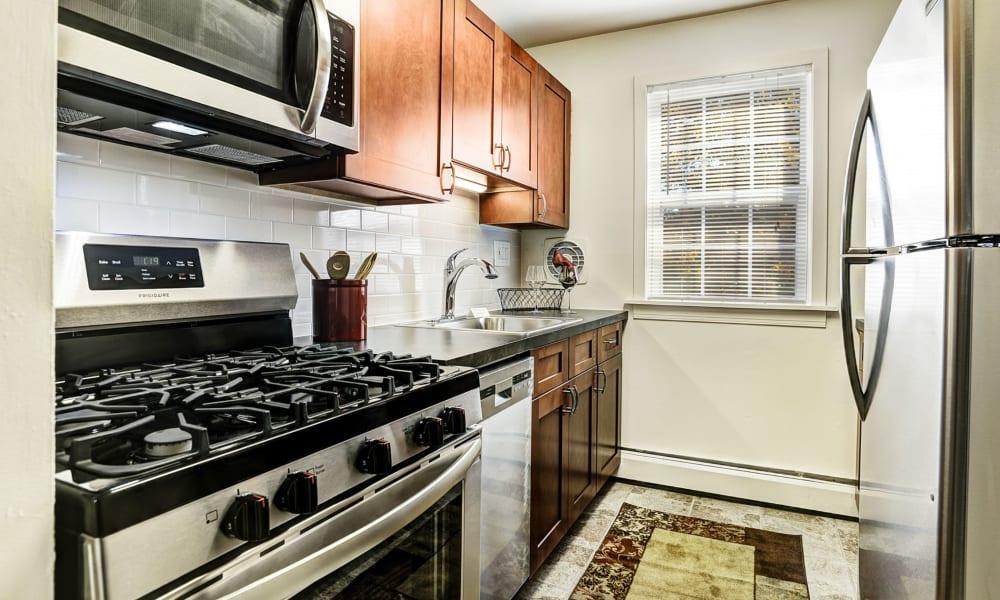 Sleek, modern kitchen at Lehigh Plaza Apartments in Bethlehem, Pennsylvania