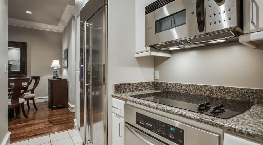 Modern stainless steel appliances at Rienzi at Turtle Creek Apartments in Dallas, Texas