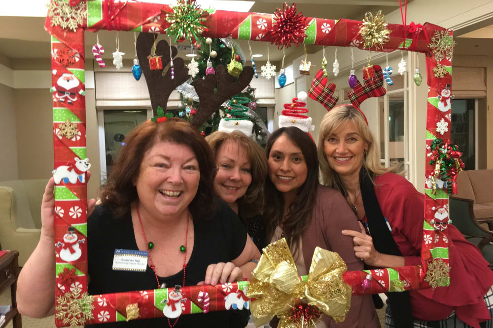 Staff in a frame at a holiday party at Merrill Gardens at Huntington Beach in Huntington Beach, California.