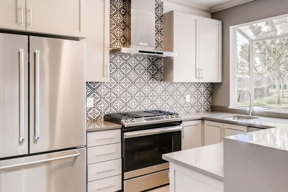 A beautiful luxury kitchen with stainless-steel appliances at Hidden Hills Condominium Rentals in Laguna Niguel, California