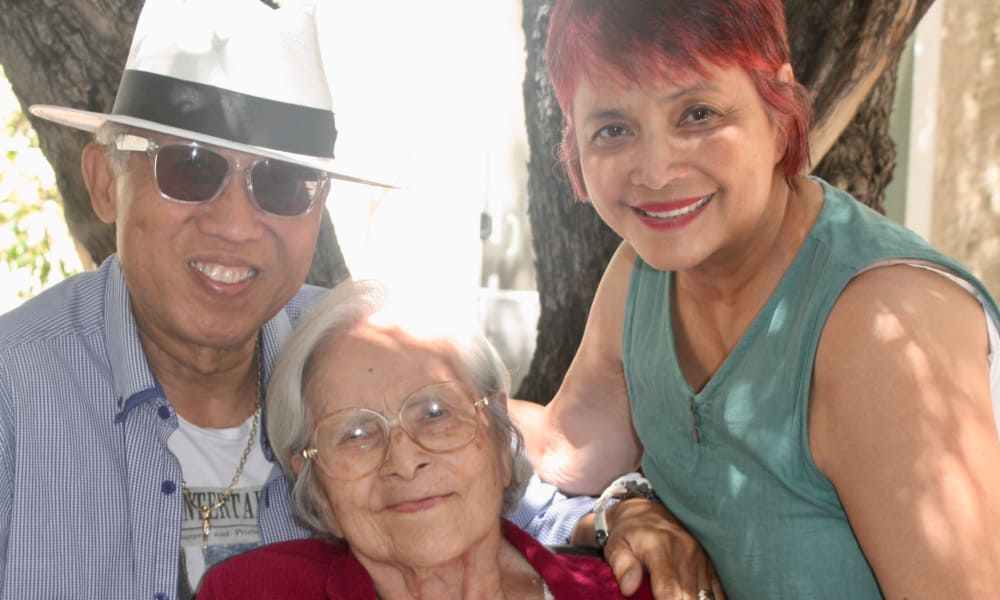 Senior woman with a younger woman and man at Regency Park Astoria in Pasadena, CA