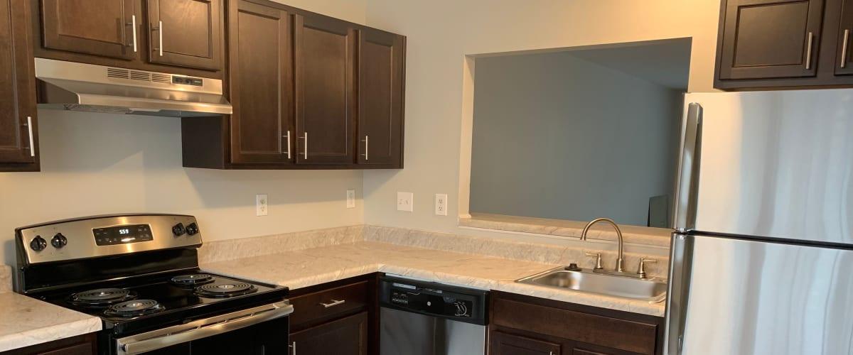 A kitchen with a pass-through window at Timber Ridge in Fredericksburg, Virginia