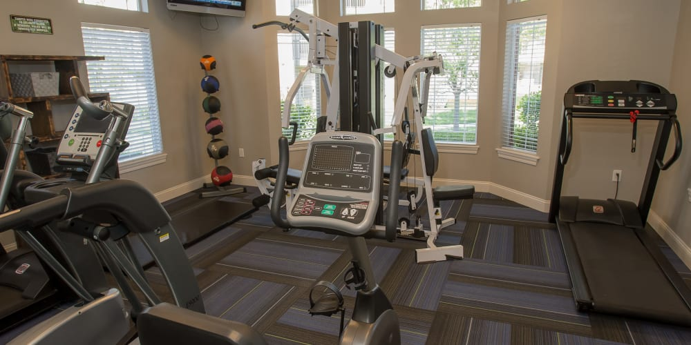 Fully equipped fitness center at Villas of Waterford Apartments in Wichita, Kansas