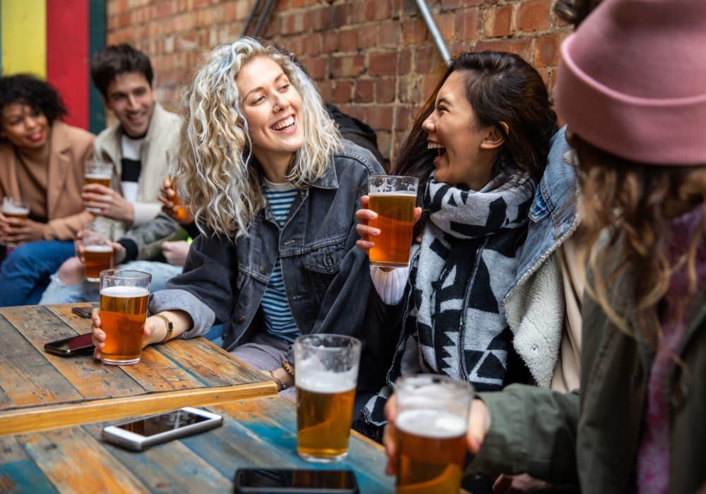 Residents enjoying drinks near Division Terrace in Portland, Oregon