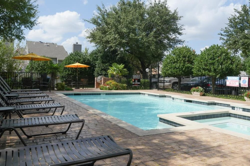 Shimmering pool and sundeck at The Park at Ashford in Arlington, Texas
