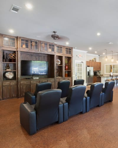 Move theater room in clubhouse at Panther Riverside Parc Apartments in Atlanta, Georgia