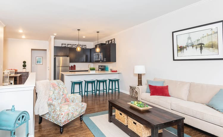 Spacious living room at North Ponds Apartments home