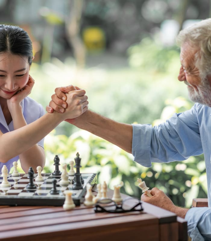 Staff member and resident playing chess at The Sanctuary at St. Cloud in St. Cloud, Minnesota