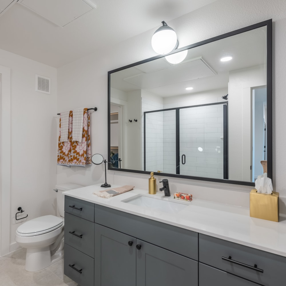 Spacious bathroom with huge mirror at The Langford in Dallas, Texas