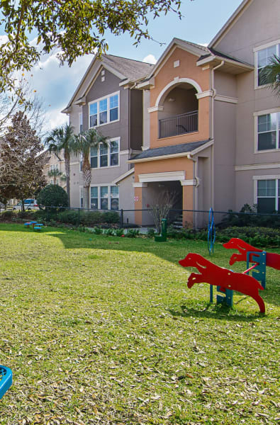 Bark park with green grass at Landings at Four Corners in Davenport, Florida