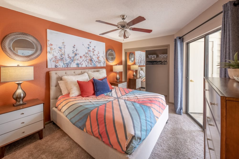 Well-lit bedroom with porch access at Ridgeview Place in Irving, Texas