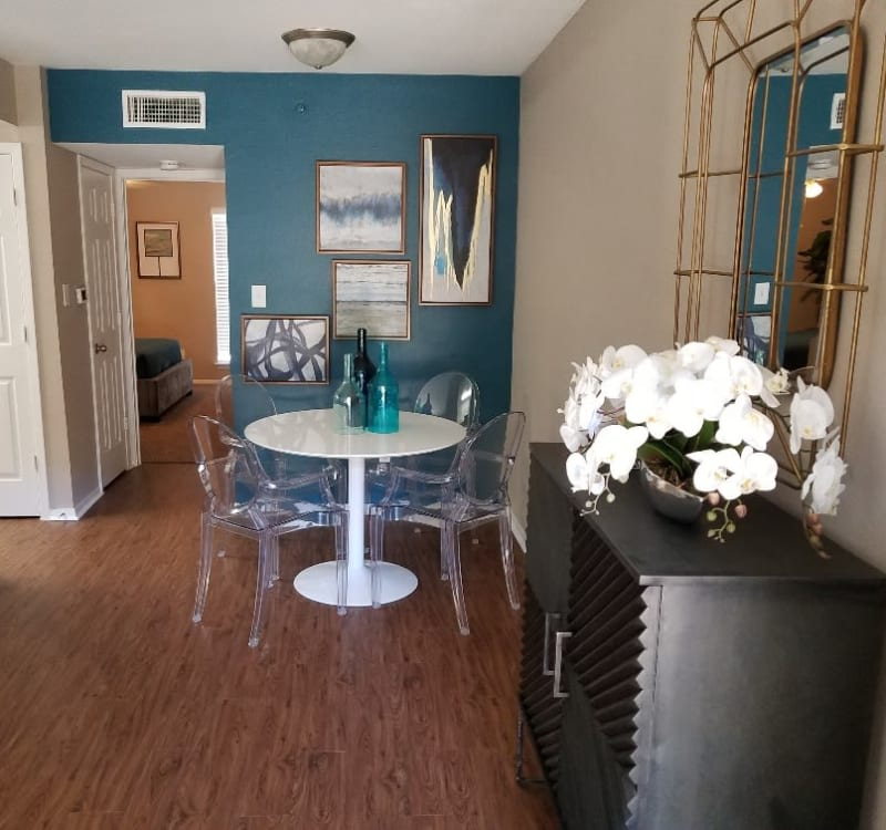 Dining area with hardwood flooring at The Villages at Meyerland in Houston, Texas