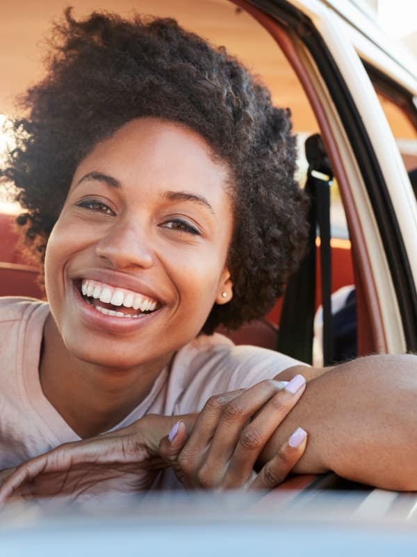 Lady driving car in Allen, Texas near Presidio Apartments