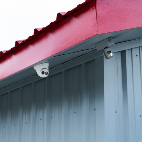 Security cameras mounted on a roof at Red Dot Storage in Denham Springs, Louisiana