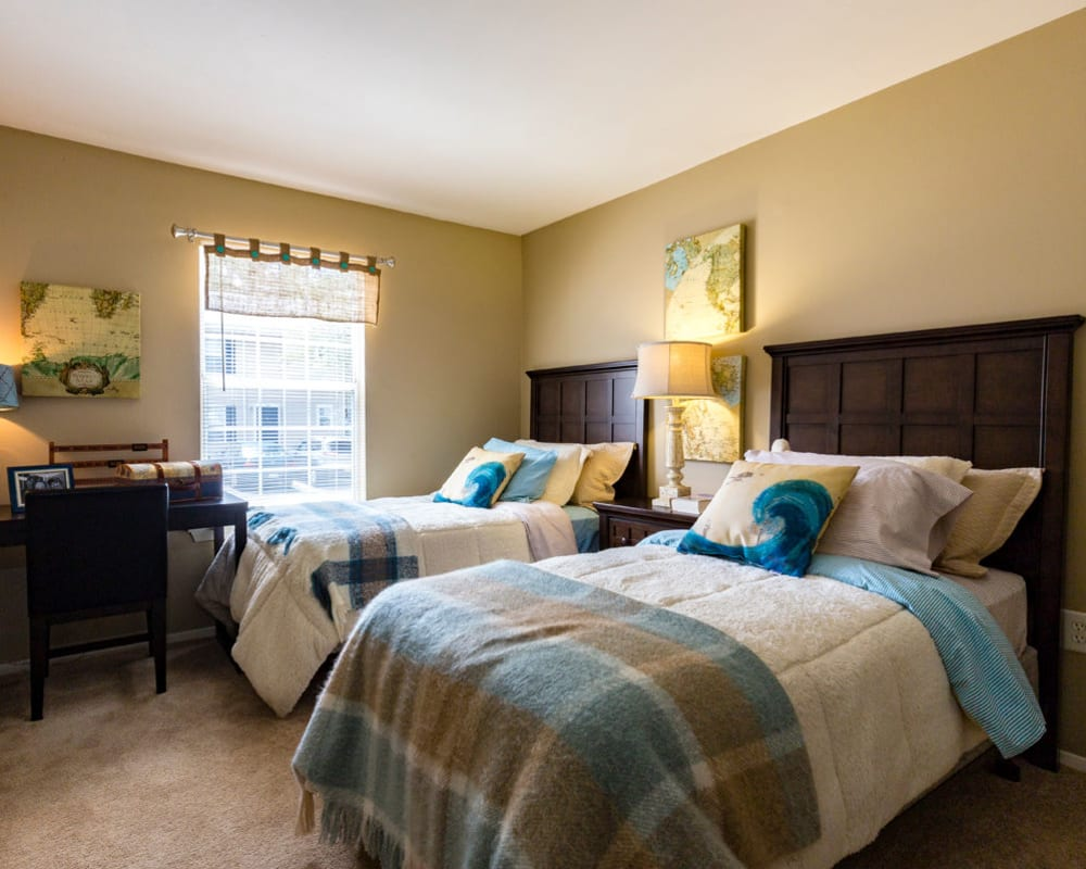 Spacious master bedroom with plush carpeting at Harbor Village Apartments in Richmond, Virginia