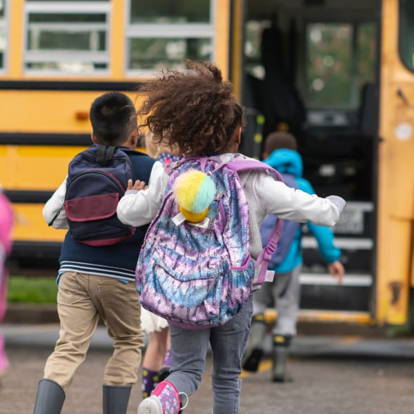 Kids loading the school bus at Windmill Terrace in Bedford, Texas