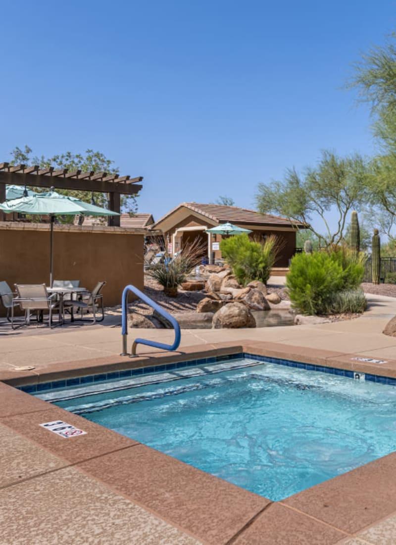 Hot tub next to community BBQ area at Marquis at Sonoran Preserve in Phoenix, Arizona
