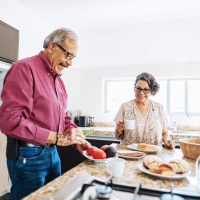 Resident couple preparing breakfast together at Marquis at Desert Ridge in Phoenix, Arizona